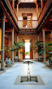 homes with interior courtyards reminds me of indian houses built mandatorily with courtyards