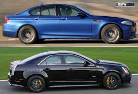 cadillac cts vs bmwblog comparison test 2012 bmw m5 vs 2012 cadillac cts v
