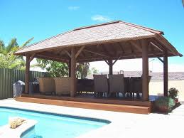 rectangular wooden gazebo with outdoor wicker chair for backyard