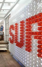 plastic drink bottles were reused to create a giant logo for this