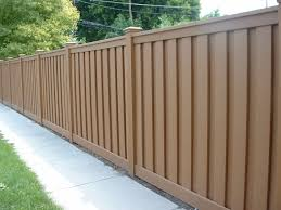 exterior brown composite trex fencing plus concrete footpath and