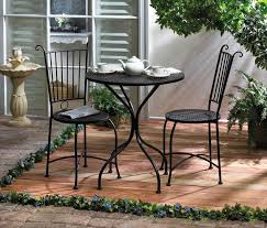 outdoor patio dining table and 2 chairs black metal lattice yard