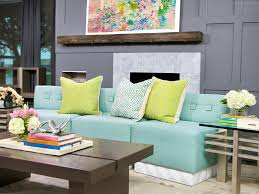 living room neutral wooden living room features mint green sofa as