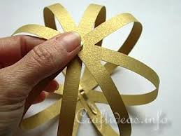 craft a delicate gold paper ornament for your tree