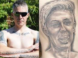 miley cyrus tattoo man carl mccoid ink pictures photos