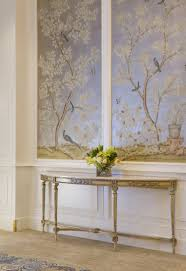 an elongated demilune gilded table is balanced by the soft sheen