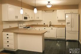 Transforming Kitchen Cabinets Kitchen Transformation White Cabinets U0026 Painted Counters With