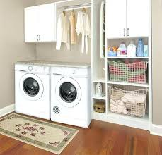 laundry storage ideas tuck a retractable clothesline into your