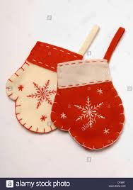 two red and cream felt mitten shaped hanging christmas tree stock
