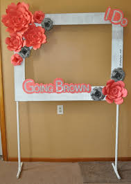 diy photo booth frame photo booth frame with paper flowers on a pvc pipe stand made by
