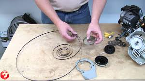 how to rewind a recoil starter spring a quick fix youtube
