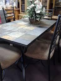 ashley antigo slate dining table antigo rectangular cocktail table w casters by signature design by