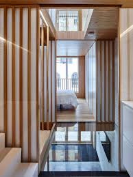 coffey architects references tea houses in revamped london mews home
