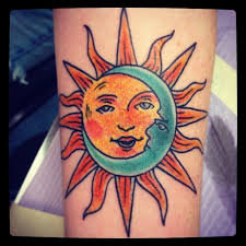 green moon and yellow sun on leg tattoomagz