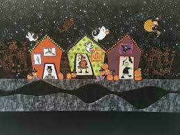 the background of halloween trick or treat a halloween quilt street pattern re make quilty