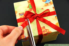 tying gift bows how to tie a gift wrapping bow 6 steps with pictures wikihow
