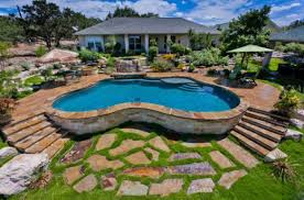 a backyard oasis picture with breathtaking backyard pool and spa