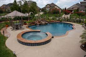exterior waterfalls legendary escapes swimming pool builder
