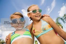preteen girl modeling two girls 7 9 in swimwear portrait stock photo masterfile