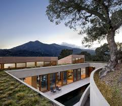 natural modern home on hill with nature surrounding hupehome