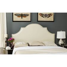 the dramatically arched hallmar queen headboard in white bicast