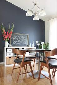 blue dining room with additional navy walls a chair rail and white
