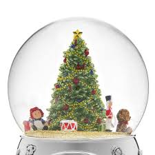 a wish christmas tree and toys snow globe