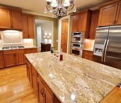 quartz countertops and golden oak cabinets oak cabinets with