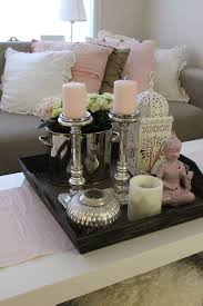 silver coffee table tray a little busy i d edit say one of the candle sticks the other