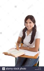 Picture Of Student Sitting At Desk by Latina High School Or College Female Student Sitting By The Desk