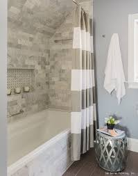 a gorgeous bathroom remodel with a tile shower trim and a