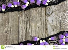 halloween candy background purple halloween candy corn and black cloth frame against wood