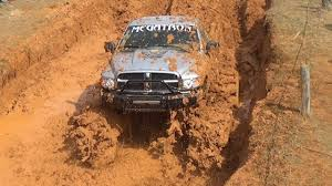 monster trucks in mud videos these monster trucks go full throttle who will make it
