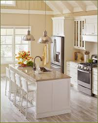 Decorating Above Kitchen Cabinets Cream Colored Kitchen Cabinets Ideas With Island Design Kitchen