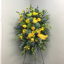funeral spray blue green yellow funeral spray by flowers in peabody ma