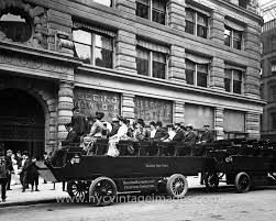 sightseeing bus in front of flatiron building 1910 nyc vintage