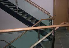 Timber Handrails And Balustrades Feature Staircase With Glass Balustrade Capped In Stainless Steel