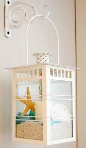 Ocean Themed Home Decor by Beach Lanterns Or Mason Jars Filled With Shells U0026 Sand
