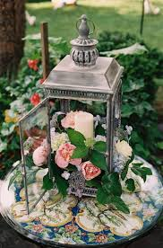 rustic wedding decor ideas flowers in lantern centerpiece deer