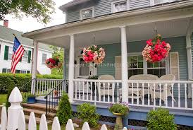 containers pot on house porch entry inviting front porch and curb