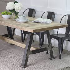 a game reclaimed wood dining table with steel a frame by rust