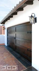 Garage Gate Design Carriage Style Garage Doors Handcrafted In A Spanish Colonial