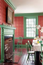 red wall and green wooden window with glass black wooden dining