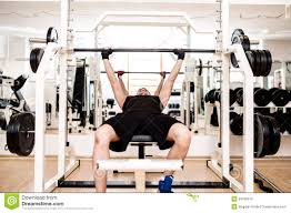 Wide Grip Bench Press For Chest Bodybuilder Training In The Gym Chest Barbell Bench Press Stock