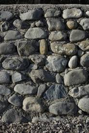 how to build a rock wall and transform your home into a fortress