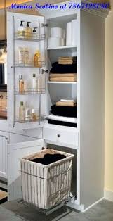 Linen Cabinet For Bathroom A Linen Closet With Four Adjustable Shelves A Chrome Door Rack