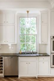 white inset kitchen cabinets with brass knobs transitional kitchen