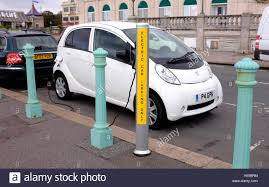 pergut car peugeot car at an electric car charging point on brighton seafront