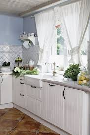 white kitchen curtains for country kitchen style and diagonal white kitchen curtains for country kitchen style and diagonal ceramic tile backsplash and modern bronze faucet and glass window decor and corner floating