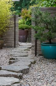 love the bamboo privacy fencing and the chunky rock pathway one